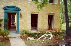 door colors for yellow brick house - Google Search  I like this teal on the yellow brick