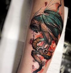 Cartoon style colored arm tattoo of big owl with snake