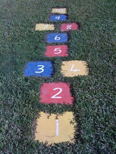 DIY back yard hopscotch - pavers, paint, shovel  Definitely gonna do this to our back yard when we own a home! :)
