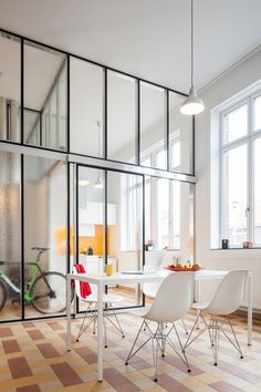 Glass partitions divide up the interior spaces of apartments created within a former school building