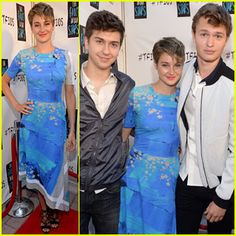 Shailene Woodley sandwiched between her co-stars Ansel Elgort and Nat Wolff during The Fault In Our Stars fan event at Dolphin Mall on May 6, 2014 in Miami, FL. Shailene's dress is by Preen, and has a blue painterly background with a sprinkle of flowers, interspersed with surprisingly contrasting beige and white geometric accents around the hem and on one sleeve.