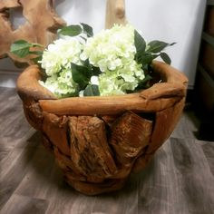 The Gili Planter potted with some gorgeous hydrangeas. Perfect for indoor and outdoor plants, the textured wood of this planter is salvaged teak root pieces that are held together with wooden dowels. Wooden dowels have been used in manufacturing for centuries and were used to build Japanese shrines in AD690 as a longer lasting method of construction.  On sale now! www.zenporium.com  .  #planter #woodplanter #teakplanter #outdoorplanter #landscaping #indoorplanter #hydrangea #teakroot Wood Planters, Indoor Planters, Outdoor Plants, Planter Pots, Japanese Shrine, Hydrangeas, Teak, Serving Bowls, Landscaping