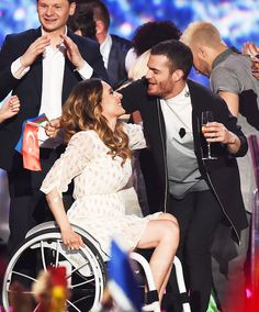 """""""Monika Kuszynska of Poland and Elnur Huseynov of Azerbaijan react on stage during the second Semi Final of the Eurovision Song Contest 2015 on May 21, 2015 in Vienna, Austria. """""""