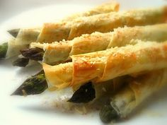 My Uncle Mark makes these - just the phyllo, asparagus, and some parmensan cheese... SOOOO Yummy!!