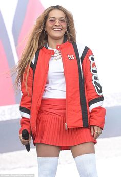 Sporty: The songstress layered a red bomber jacket on top, emblazoned with her name down t...