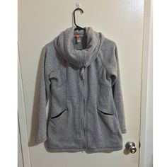 Lucy Activewear Funnel-neck Jacket I'm selling this super cool Lucy Activewear jacket with extra big collar. The jacket is long, goes past the butt, with pockets and adjustable hem. Size small, fleece-like soft material (100% polyester). No trades please. Lucy Jackets & Coats