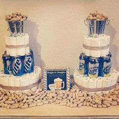 Pin for Later: Huggies and Chuggies: 20 Cakes For Your Partner's Man Shower Snack Attack We don't know the symbolism of the peanuts, but we don't hate that they're there. Baby Shower For Men, Man Shower, Couples Baby Showers, Baby Shower Niño, Baby Shower Diapers, Baby Shower Gender Reveal, Baby Shower Parties, Baby Shower Themes, Shower Ideas