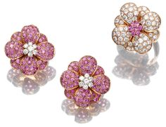 Van Cleef & Arpels - Pink sapphire and diamond demi-parure - Comprising a pair of ear clips each of floral design pavé set with circular-cut pink sapphires, set to the centre with a cluster of brilliant-cut diamonds, clip fittings; and a ring set to the centre with pink sapphires, the petals set with diamonds, size 53; all mounted in yellow gold.