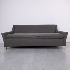 Dove Mid-Mod Sofa. - Mid-century style three-seat soft gray couch- Good condition overall