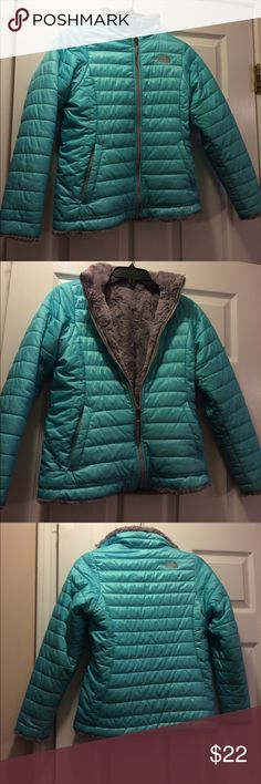 Girls Northface  jacket This beautiful aqua Northface girls jacket is in good condition.  It has a gray faux fur lining and had been gently used .  This is reversible jacket !! There is no tags but my daughter is petite.           I would say it's a girls small 7-8 as I have others in my closet for sale . North Face Jackets & Coats