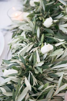 Olive leaves and white roses for the table decoration of your wedding  #realwedding #weddingplannergreece #weddingdeco