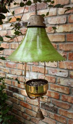 Upcycled birdfeeder.  Love the idea of the pendant light as the cap.  I like the idea of the bell underneath, but I'd take the clanger out of it so it doesn't scare the birds away.