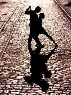"""The tango may end, but passion's fire blazes on in """"The Last Dance."""" The romantic final pose of two silhouetted tango dancers is imparted with a sense of eternity by surrounding train tracks which extend into infinity. Elongated shadows cast upon quaint c Dancing In The Moonlight, Dancing In The Dark, Tanz Poster, Danse Salsa, Dance Like No One Is Watching, Argentine Tango, Shall We Dance, Salsa Dancing, Ballroom Dancing"""