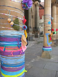 Yarn bomb event, pillars decorated with yarns, knitting and crochet