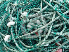 LUARCA, SPAIN - DECEMBER 4, 2016: Green fishing net with white floats at the fish market pier in Luarca, Spain.