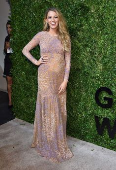 blake lively For what seemed like her official bump reveal, Blake picked a feminine Michael Kors gown covered in white and violet blooms.