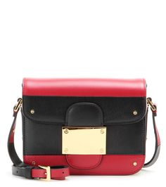 Valentino - Rivet Mini leather shoulder bag - Move over two-tone - Valentino is proving that it's all about the tri-tone colour variation. A vibrant pop of lipstick red against black and cream reflects the Italian pop art mood that inspired this collection. It's practical too, with three separate compartments ready to hold your essentials. Style with a girlish dress for sugar-sweet impact. seen @ www.mytheresa.com