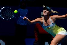 Maria Sharapova stretches for a forehand during her straight sets win over Olga Puchkova during the first round of the 2013 Australian Open.