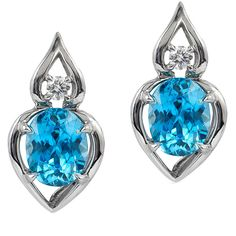 The 'Pantea' earrings set in palladium features a pair of 5.87 carat Blue Zircon accented by fine round Diamonds.