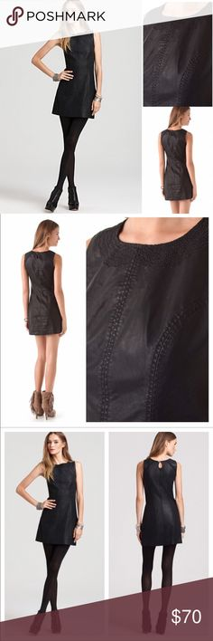 NWT Free People Vegan Leather Shift Dress Black Ew with tags vegan leather shift dress.  Embroidery around the color and black on black detailing through out.  The dress is absolutely stunning.  Looks and feels like real leather.  Crewneck, sleeveless Button behind neck with keyhole, concealed side zip Embroidered collar, lined Free People Dresses Mini