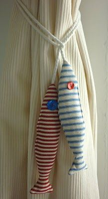 Curtain tiebacks made of ticking fabric, stuffed with lavendar.  Clever idea:  nautical, fish, stripes, curtains