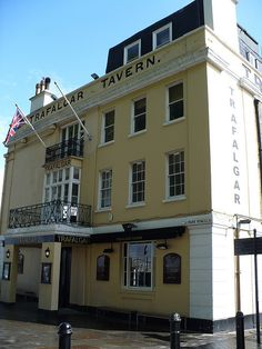 Trafalgar Tavern, Park Row, Greenwich. Built in 1837, this is a magnificent example of a Regency-style pub. It used to be the venue for Whitebait Suppers attended by Members of Parliament. In 1915, the Trafalgar became a seamen's hostel and later a working men's club. It was re-opened as a pub in 1965.