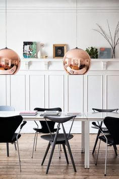 Love the brass pendant lighting, but I'd hang just one over a farm style dining table.