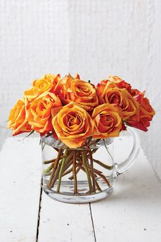 STEP 3  Change the water every other day. First, remove a few stems from the center of the arrangement. Flip the pitcher to drain it, holding your hand on the flowers to keep them from toppling out. Fill with fresh water, and return roses.