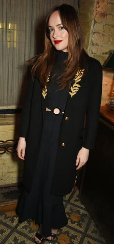 Dakota Johnson wearing a Burberry cashmere coat to attend the Burberry Weinstein Films event last night