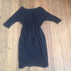 """NWOT VS Surplice LBD Never worn black surplice faux wrap dress. Boat neck front and a v-neck back. This dress is reversible so v-neck can be worn in the front or back! Measures approximately 42"""" from shoulder to hem. NWOT. Victoria's Secret Dresses Midi"""
