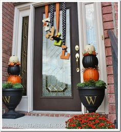 Fall Front Porch by Sand & Sisal - aren't these pumpkin topiaries fun? The letters on the door would be easy to make and you could do it for different holidays