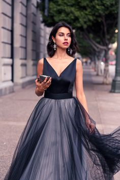 """Classic shades of grey """"glamor-ified"""" with satin, the volume from the tulle covered skirt, and a metallic clutch."""