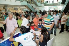 SBI Life celebrates Fathers Day at two cities - Kolkata & Mumbai (South City Mall & Mumbai - Infiniti Mall, Malad). The visitors are registering themselves for playing the Augmented Reality Game.