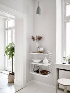 Today's home tour is a bright and airy Gothenburg apartment that exemplifies the kind of effortless Scandinavian style that I'm always drawn towards. Grey Walls Living Room, Living Room Furniture, Light Grey Walls, Black Walls, Home Staging, White Floorboards, Casa Milano, String Shelf, Home Interior