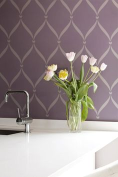 With a flat and gloss paint technique (matte painted walls and gloss paint for the stencil in the same color), you can stencil the Ribbon Lattice Wall Stencil in a lovely tone-on-tone stencil treatmen
