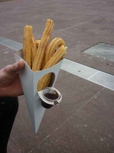 Churros with a dippable chocolate sauce container.
