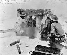 BRITISH ARMY NORTH AFRICA 1942 (E 15560)   A British six pounder anti-tank gun crew in action in the desert.
