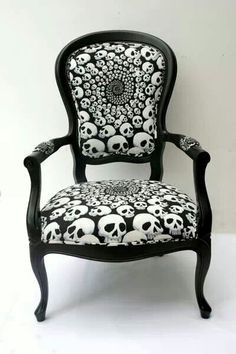 Skull skeleton pattern fabric covered chair.