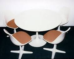 I have my mum's Arcana dining set, with bright orange cushion pads