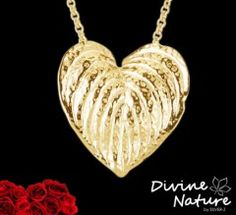 """Heartleaf""  14 k gold plated silver pendant with a gold plated chain enclosed.  Inspired by the flower Peace Lily"