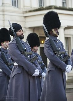 Guardsman Jatenderpal Singh Bhullar (left), the first Guardsman to wear a turban while guarding the Queen, is pictured on parade at Buckingham Palace.