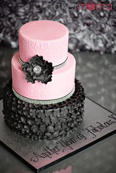 'Another Year of Fabulous' pink & black cake - 'Another Year of Fabulous' cake for a 60th birthday. Pink fondant with royal icing stencil and black fondant ruffles.