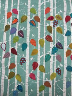 leaf sampler quilt-such fun to play with embellishing the same leaf shape differently on a preprinted tree/bird swath of fabric