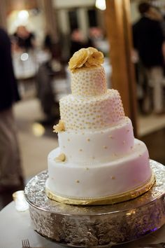 Four-tiered wedding cake with gold piped design and gold flowers {Liz Solaka Photography}