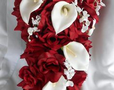 Cascade wedding bouquet roses aster, callas and roses.Measuring about 14 long and 10 wide . Made of all open roses . This item can be possible made in other colors and additional pieces can be added . Change of flowers or adding additional items to the bouquet can cause the price to change please ask before purchasing. 1 Bride bouquet 1 Free Groom bout Processing time can varied depending in the amount of order we have usually it will take between 2 to 3 weeks for us to made and send a order…