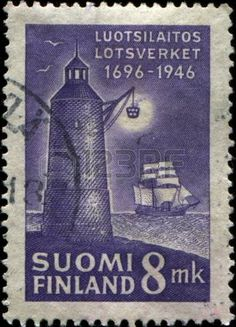 FINLAND - CIRCA 1946: A stamp printed in Finland shows Lighthouse and sailboat, circa 1946  photo