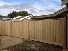 Paling front feature fence with exposed posts, points and capping with double gates. Styles of fences