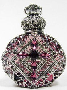 silver perfume bottle by mistymorrning