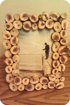 """homemade wood slice picture frame. I'm thinking a picture of Wyatt """"chopping"""" wood with Poppio would be would be perfect for this!"""