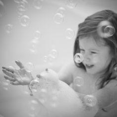 Bubble machine + bath time photo shoot = priceless (good idea for outdoor pics also)